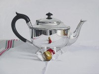 Alan Kingsbury Silver teapot with two Chocolates